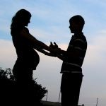 1098253_silhouette_of_pregnant_woman_and_her_husband